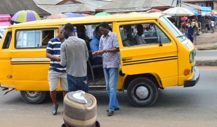 Funny But Nice!! Lagos Conductor Seen Sanitizing Passengers Hand With Seaman Schnapps (VIDEO)