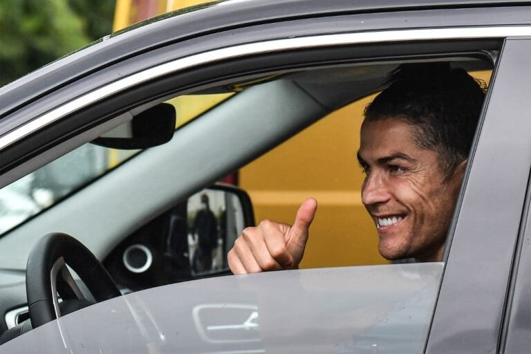 MAD O!! See Photo Of Cristiano Ronaldo Closely Followed By Bodyguards On His Way To Training